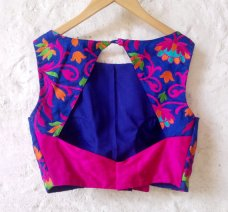 Blue Padded Silk Blouse with Bright Floral Embroidery and Fuschia Raw Silk detail at Back. Comes in Size (L) #DesignerSareeBlouses