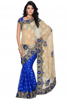 Beige and blue faux chiffon jacquard and net jacquard half half saree designed with resham, zari, sequins, applique and patch border work. Available with blue art silk blouse fabric, blouse shown in image is for photography purpose only.  #Chiffon(fabric) #Sari #Jacquardweaving #Blouse #Sequin #Appliqué #Zari #Beige #Yarn