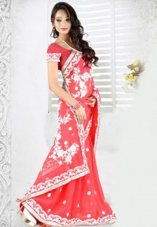 Add a dose of panache to your look with this beautiful pink faux georgette saree designed with cotton thread, lace and patch border work.  #Sari #Georgette(fabric) #Blouse #Yarn #Textile #Lace #Cotton